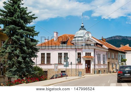 Belogradchik, Bulgaria - May 31, 2016: Vibrant image of Belogradchik, Bulgaria town scenery with old houses and street view