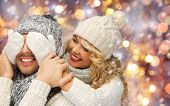 Постер, плакат: people christmas holidays and new year concept happy family couple in winter clothes playing gue