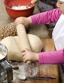 stock photo of flour sifter  - A young girl having fun in the kitchen making a mess - JPG
