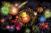 stock photo of brighten  - Fireworks of different colors brighten the night sky - JPG