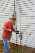 foto of pressure-wash  - Contractor pressure washing house removing mildew  - JPG