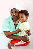 african american domestic worker hugging kid poster