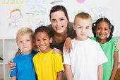 picture of young boy  - group of preschool kids and teacher in classroom - JPG