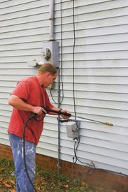 pic of pressure-wash  - Contractor pressure washing house removing mildew  - JPG