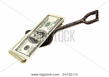 Dollar Bills Stack On Grunge Antique Shovel