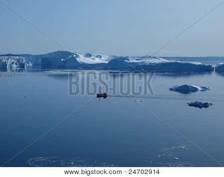 Fishing boat in Ilulissat Icefjord,