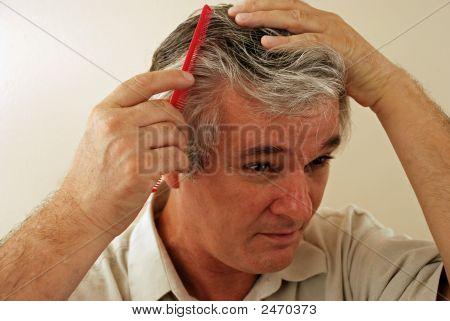 Senior Gentleman Combing His Hair