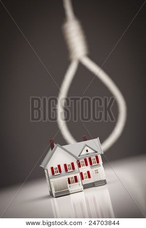 Small House with Hangman's Noose Behind on Grey Background.