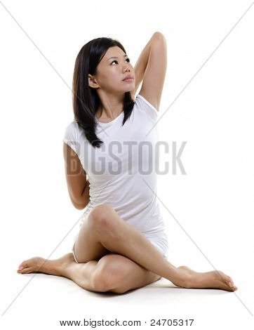 Woman in yoga, Cow Posture (Gomukhasana), on white background