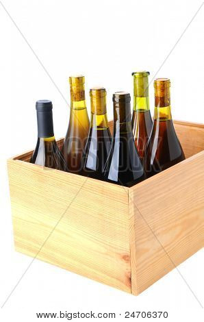 Six bottles of Chardonnay wine Standing up in a wooden case over a white background