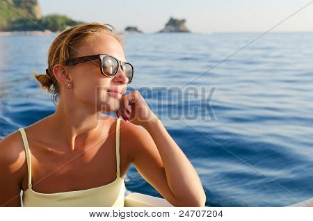 Red woman on a yacht cruise