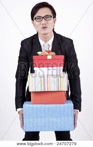Asian Bussiness Man With Stack Of Gifts