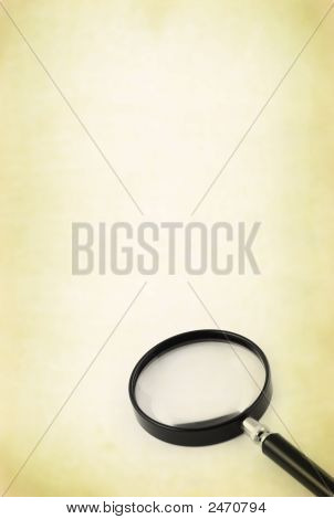 Magnifying Glass Against Retro Background