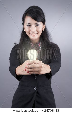 Beautiful Business Woman With A Lightbulb