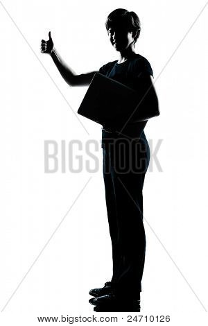 one caucasian young teenager silhouette boy  girl holding carrying laptop compter thumb up full length in studio cut out isolated on white background