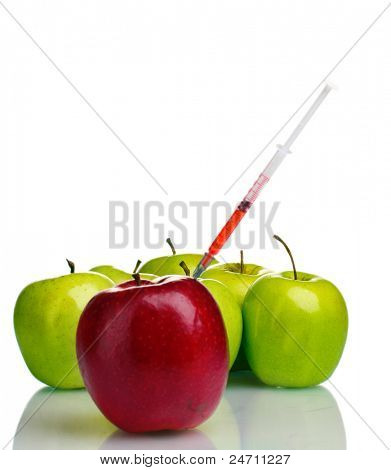 red and green apples and syringe isolated on white