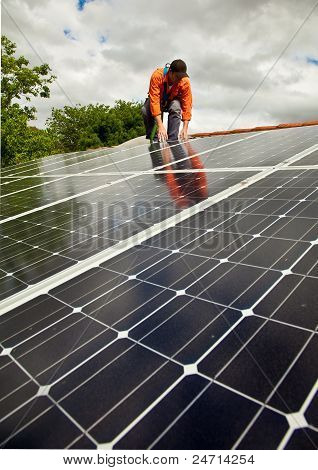 Electrician checking solar panels