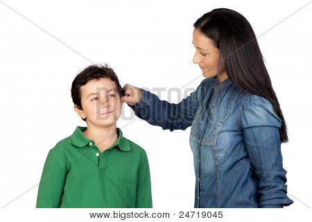 Mother pulling her child's ear for being naughty isolated on white background