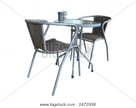 Two Chairs At A Glass Topped Table