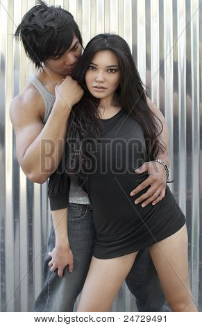Attractive young couple in fashion pose