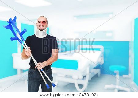 young man with crutch at hospital