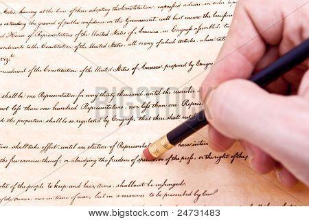 Closeup Of Hand Pencil Erasing First Amendment To U.s. Constitution
