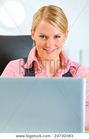 Happy Business Woman Working On Laptop At Office