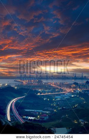 Taipei port's sunset and a highway through the port it