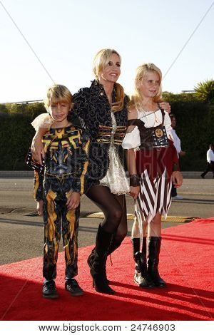 LOS ANGELES - OCT 29:  Camille Grammer, daughter Mason and son Jude arriving at the 18th Annual 'Dream Halloween Los Angeles' at Barker Hanger on October 29, 2011 in Santa Monica, CA