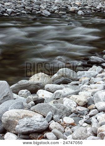 Beautiful Wild River In The Mountains Covered With Stones