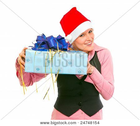 Interested Business Woman Shaking Present Box Trying To Guess What's Inside