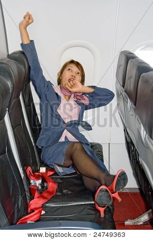 Stewardess resting on a plane