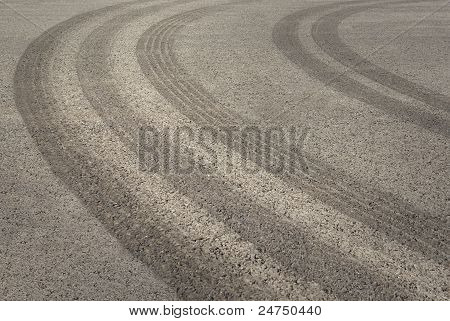 Tire Tracks On Asphalt