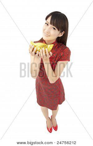 chinese woman wear cheongsam and holding gold ingot