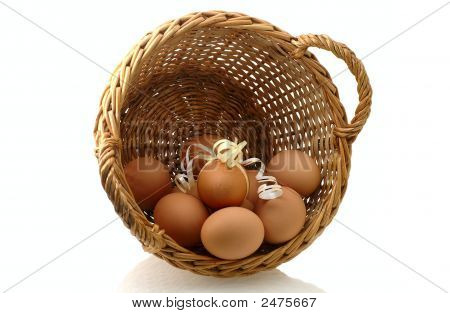 Few Eggs In Basket With One Decorated