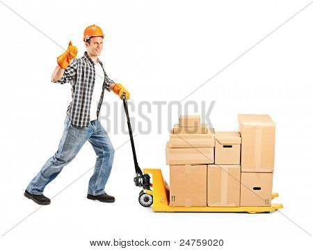 Full length portrait of a manual worker pushing a fork pallet truck stacker isolated on white background