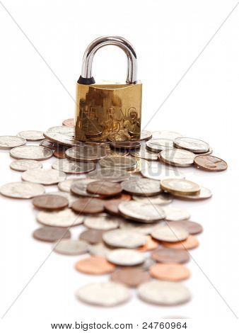 Padlock on coin pile as a symbol of financial protection isolated on white background