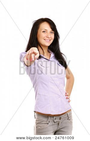 Portrait of charming young female pointing at you against white background