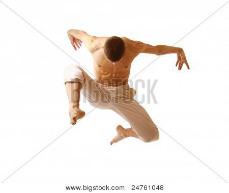 young man jumping high on isolated white background