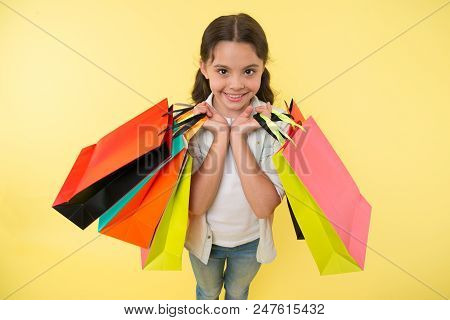 poster of Fashion Expert. Child Cute Shopping Expert Helps Carry Packages During Shopping. Little Shop Expert.