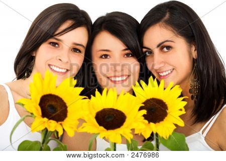 Beautiful Female Friends Holding Sunflowers