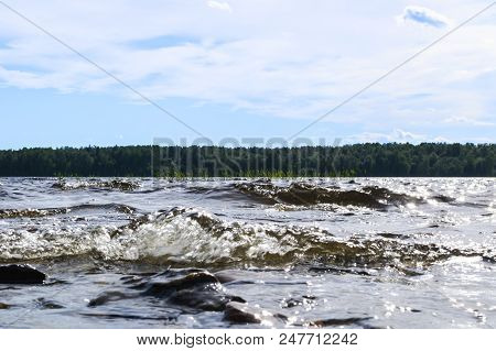 poster of Big Windy Waves Splashing Over Rocks. Wave Splash In The Lake Against Beach. Waves Breaking On A Sto