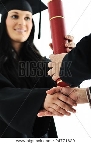 Graduate girl student in gown receiving diploma