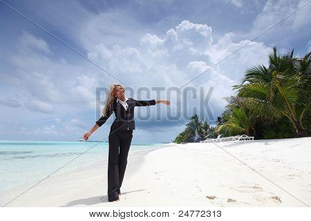 happy  business woman on the desolate ocean coast