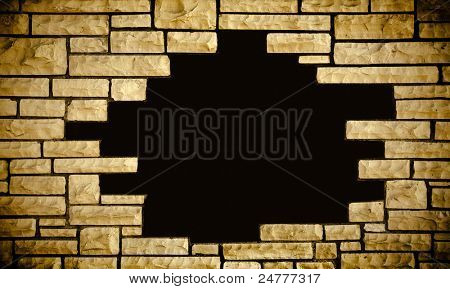 concept of fear and spooky black obscurity in the hole of vintage stone wall texture