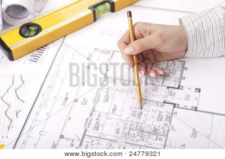 Pencil, Hand, Blueprints On Desk