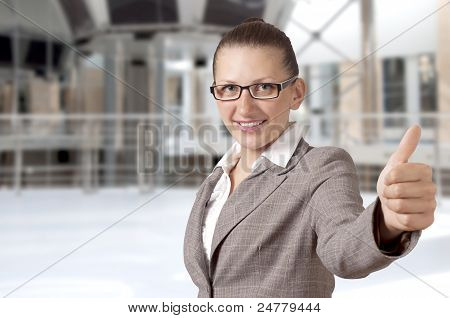 Businesswoman Showing His Thumb Up With Smile
