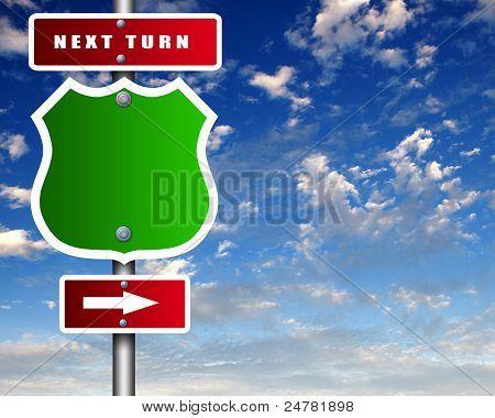 Road sign agaisnt blue sky