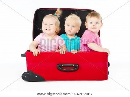 Children Sitting Inside Red Suitcase