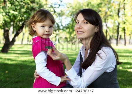 Mother with her daughter in summer park